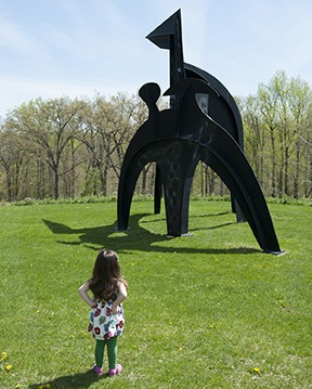 "A 3-year-old studies ""Black Flag"" an Alexander Calder sculpture from 1974 at the Storm King Art Center - HILLARY HARVEY"