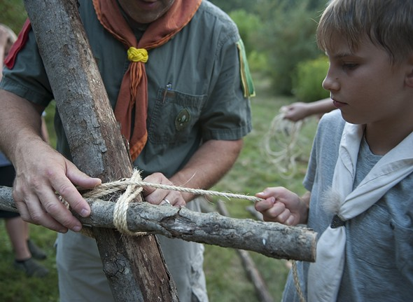 The Pathfinders (ages 11-17), the largest section of the 91st Sojourners, lash together three logs to build a tower - HILLARY HARVEY