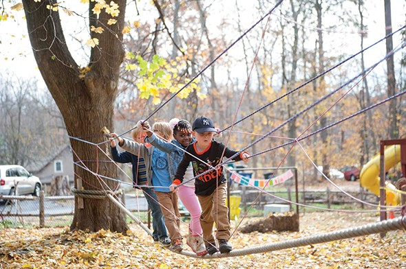 K-1 students climb the obstacle course during Forest Mondays at Randolph School. - HILLARY HARVEY