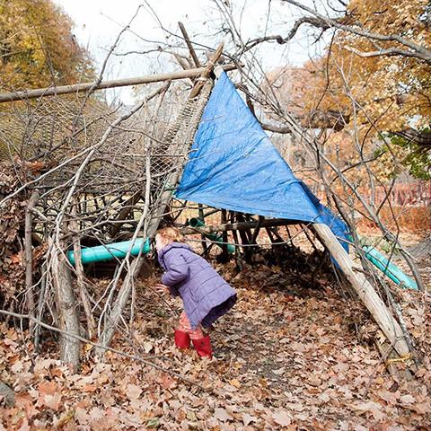 Playing in the debris hut at the Randolph School - HILLARY HARVEY