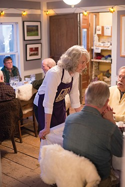 Farmer Carol Clement takes a short break from serving to chat with her guests. - JIM MAXIMOWICZ