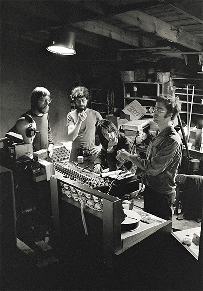 A weary Todd Rundgren at the board during The Band's Stage Fright recording sessions, Woodstock Playhouse, early summer 1970 (left to right: John Taplin, Robbie Robertson, Rundgren, and John Simon - JOHN SCHEELE