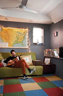 """Morgan Taylor in the """"hang-out room"""" where he often takes breaks from the family routine to record his inspiration and ideas. His voice memos have become an inadvertent family time capsule—over the years catching snippets of his children playing, crying, cooing, and growing up in the Hudson Valley. - DEBORAH DEGRAFFENREID"""