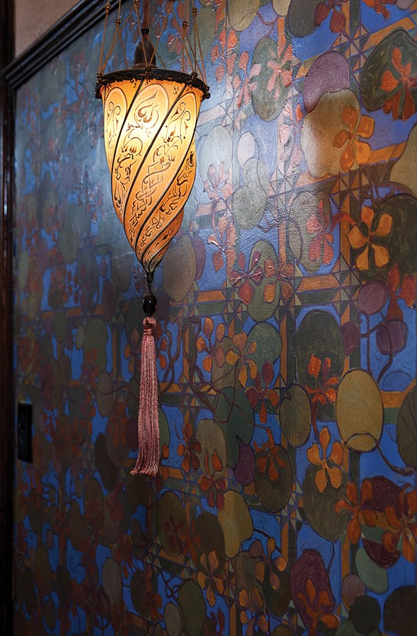 A wall in the home's entranceway. The artist Thomas Donahue hand painted murals throughout the house. - DEBORAH DEGRAFFENREID