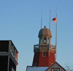 Evidence of the Valentine's Day Bandit flies atop the Portland Observatory, Portland, Maine. - AMANDA PAINTER