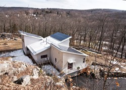 Situated on a south-facing slope, the home was built to take full advantage of seasonal light and is powered by solar panels. A geothermal heating and cooling system regulates the home's temperature throughout the year. - DEBORAH DEGRAFFENREID
