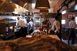 Pelaccio and crew in the Fish & Game kitchen. - PETER BARRETT