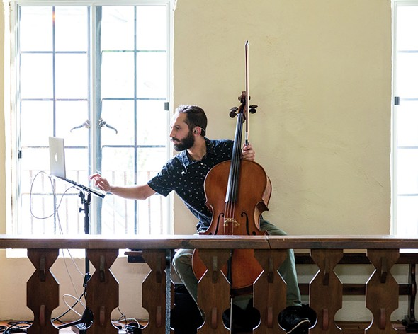 Cellist Daniel Frankhuizen performing at Colony Woodstock during the opening social hour. - RICHARD A. SMITH