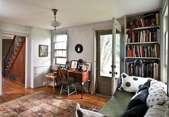 "The library and study area of Shaff's home. True to the spirit of gothic architecture, the home's ample doors and windows invite the outside in. ""One of beauties of being in the woods is affirming your own romantic natural essence—your animal being,"" Shaff explains. - DEBORAH DEGRAFFENREID"