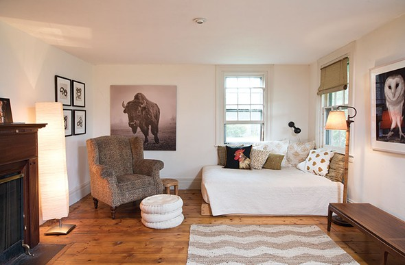 Like the rest of the house, the living room is decorated with Shaff's images. She's found that the photos that most resonate with people are analog images that are scanned and digitally printed. - DEBORAH DEGRAFFENREID