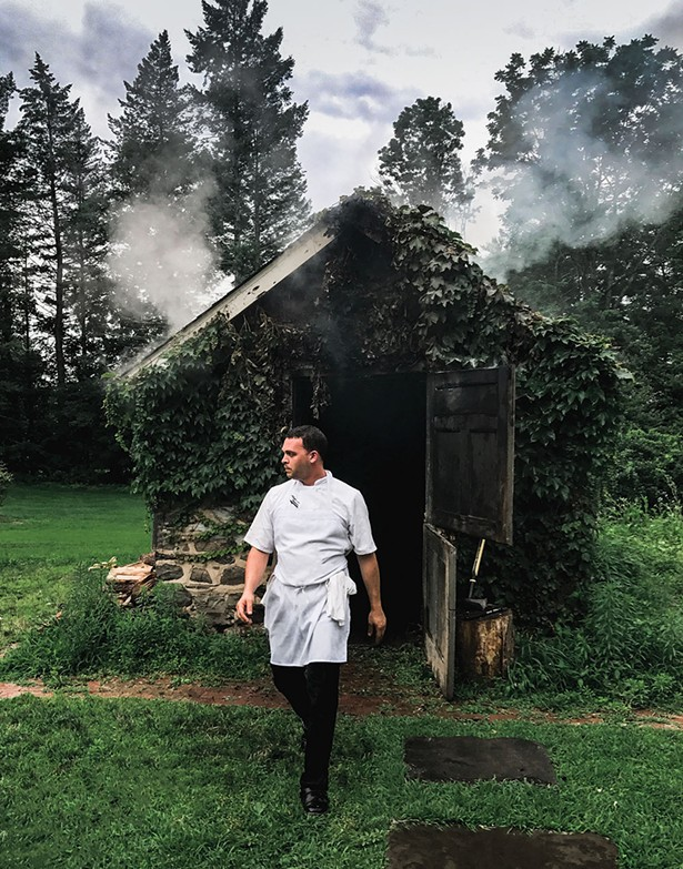 Chef Aaron Abramson leaving the smokehouse.