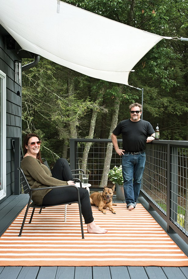 The whole family gathered on the back deck.Decorated with simple awnings and a beer garden table, it's a popular summer spot.A high powered telescope—a wedding gift from Stenger's office—helps them take advantage of the dark, upstate nights and keeps them starry-eyed all year long. - DEBORAH DEGRAFFENREID