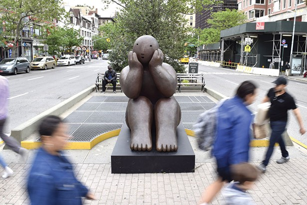 "Sitter with head in hands, a bronze by Joy Brown in Manhattan, part of the exhibit ""Joy Brown on Broadway."" - PHOTO BY KATHERINE MANNING"