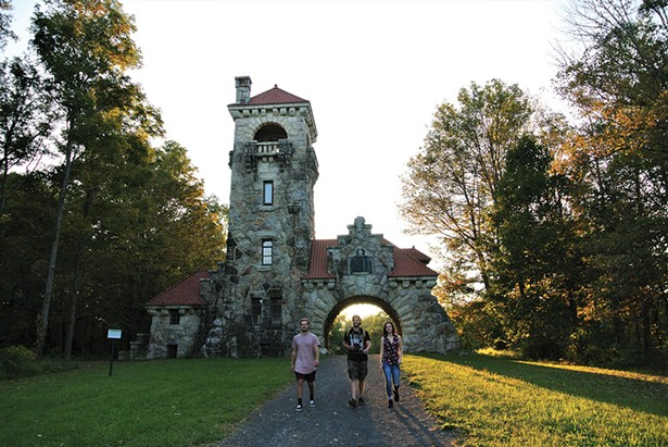 Howie Birch, Tyler Koester, and Grace Birch at the Testimonial Gatehouse on the Mohonk Preserve. - JOHN GARAY