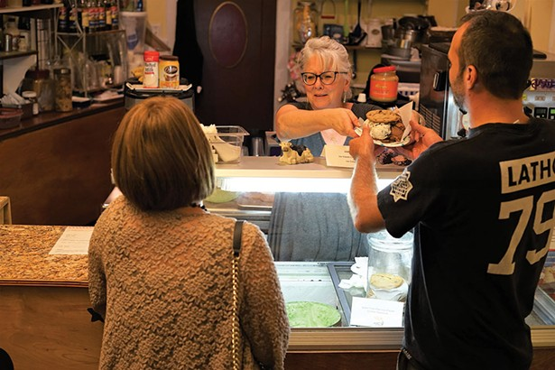 Charles and Sara, patrons of Huguenot Creamery, with Creamery owner Pat Walker. - JOHN GARAY