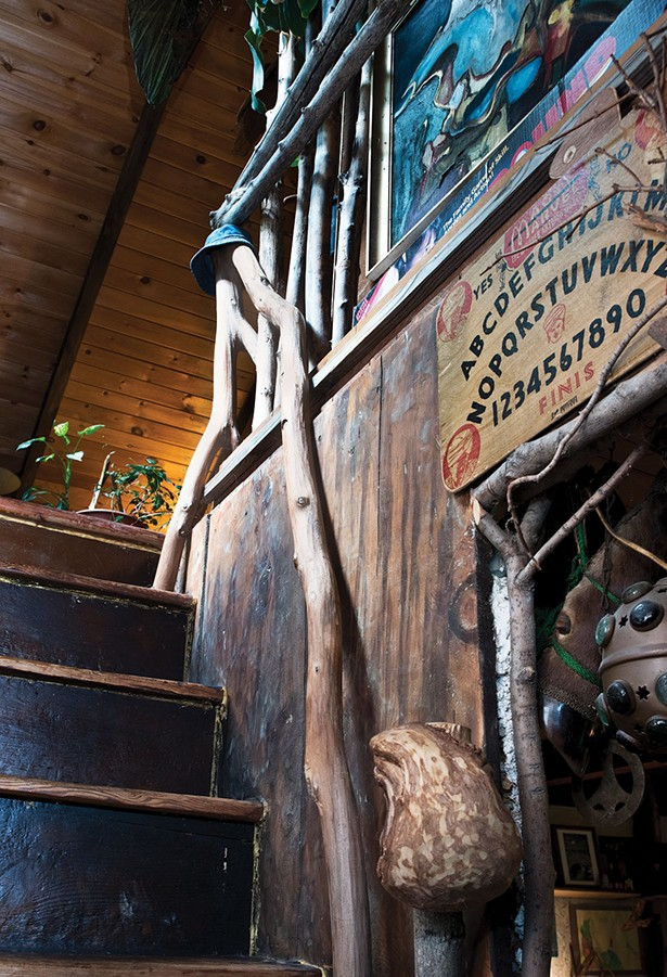 """Perrin created a staircase and railings out of branches collected from the surrounding woods. The couple have amassed a storehouse of natural treasures, artifacts, and recycled materials for use in their home's restoration, their own works or to share with workshop participants.""""We have more than enoughsupplies for all of the Hudson Valley,"""" Shaftan Perrin explains. - DEBORAH DEGRAFFENREID"""
