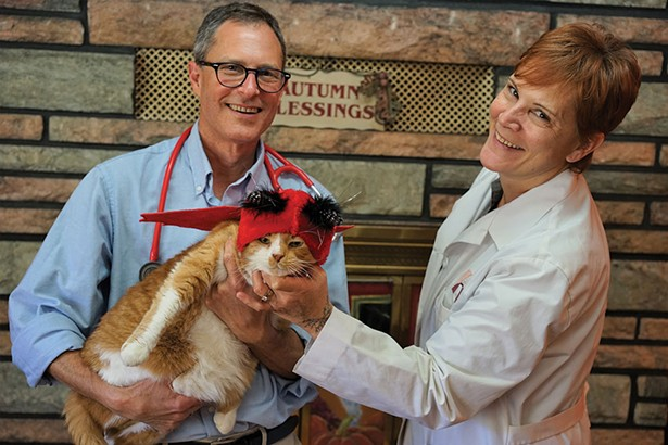 Doctors Jerry Scheck and Kim Buchanan with Oliver at Hopewell Animal Hospital. - JOHN GARAY