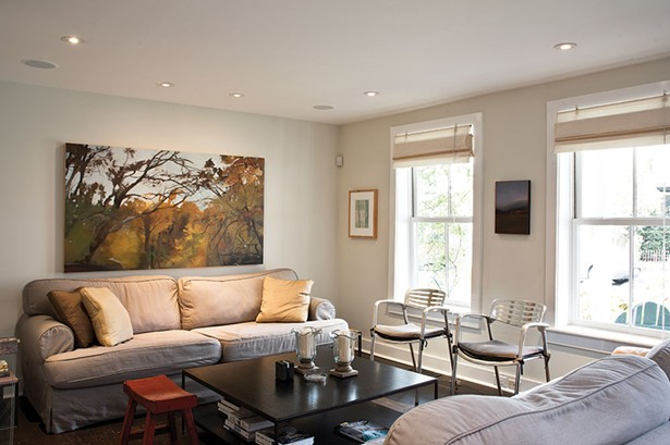 """The living room is decorated with a mix of contemporary and antique pieces. """"We really tried to keep it anchored in Hudson; the furniture is historic but true to the home's character,"""" says Smith. - DEBORAH DEGRAFFENREID"""