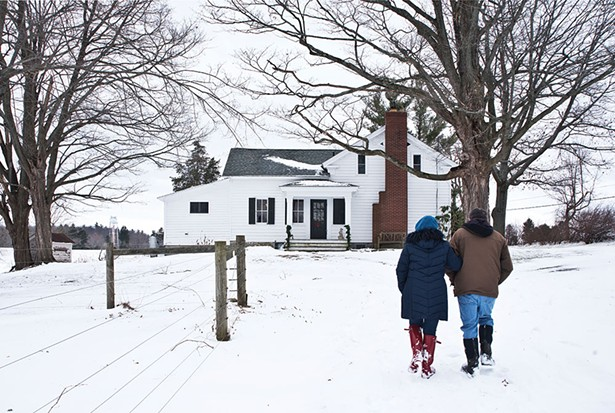 Jamie Cat Callan and Bill Thompson on their Valatie farm. The 19th-century federalist house features the original clapboard siding, and gabled roof with cornices. The original brick chimney and plain window surrounds are also classic features of the period. - DEBORAH DEGRAFFENREID