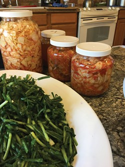 Traditionally, kimchi was stored in stone pots, settled into the ground, but today, ingredients fill glass jars and stay fresh in a dedicated refrigerator. - JOAN MACDONALD