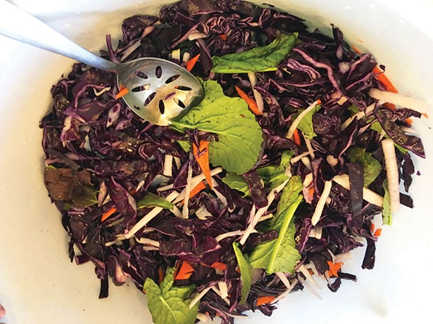 Shreds of crunchy red cabbage are mixed with daikon, carrots, and mustard greens to create a distinctive kimchi. - JOAN MACDONALD