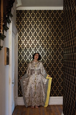 """Khorramian wearing one of her silk """"kaftoons."""" Designed for her clothing company, Laloon, the combination kaftan/kimono is made from three different fabrics and stitched in Catskill. - DEBORAH DEGRAFFENREID"""