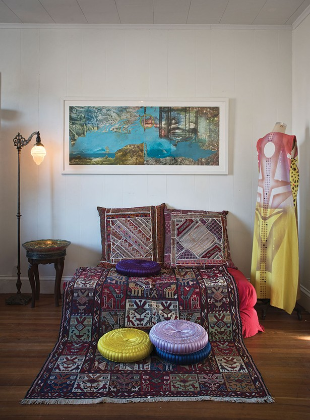 Antonia, one of Khorramian's paintings of oil on polypropylene created in 2006, hangs next to a hand painted raw silk tunic from Laloon. Pillows and a traditional handcrafted Iranian carpet sit below. - DEBORAH DEGRAFFENREID