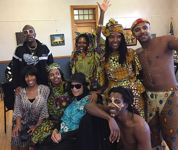 The Badilla family—Milandou, Nkoula, Ntangou, Ntchota, Ngounga, Mounnanou, and Pamela— with Gloria Stewart and Debbie Waithe at the Hudson Area Library.