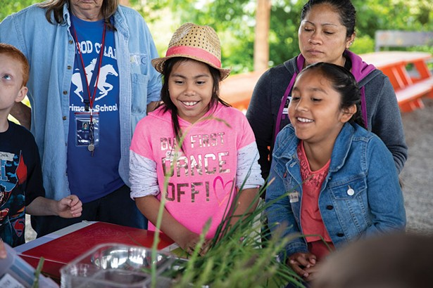 Students from Ichabod Crane Elementary School at Katchkie Farm. After weeding, cultivating garden beds, planting seeds in the greenhouse, and harvesting rhubarb, students worked as a group to prepare green vegetable fried rice and rhubarb applesauce with toasted oats for dessert.