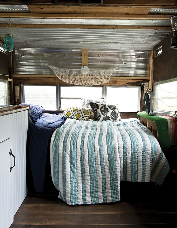 The couple's trailer bedroom. The interior of both structures was restored with scavenged and recycled materials, including metal and wood from the property's razed house. - DEBORAH DEGRAFFENREID