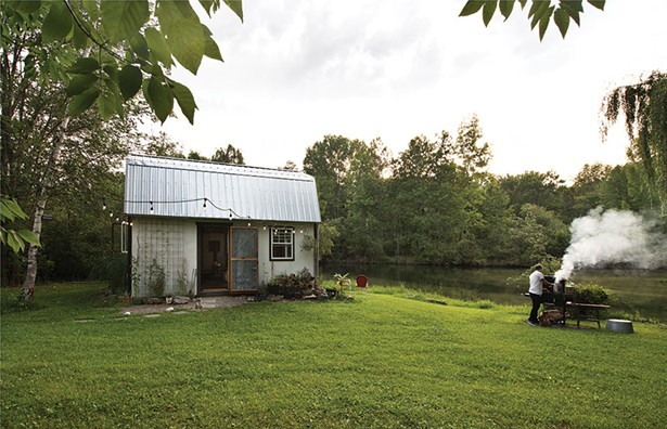 """The exterior of the studio shed with Covelli at the BBQ.""""I would like someone to monetize the sweat equity we›ve put out into the world, over the past 20 years,"""" he says. - DEBORAH DEGRAFFENREID"""