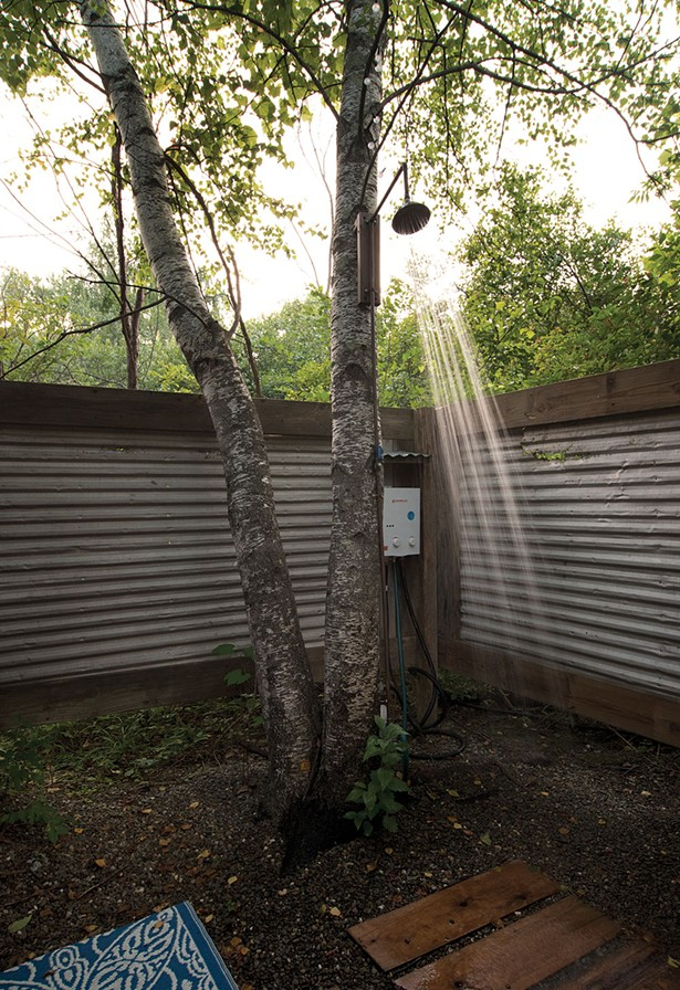 Built by Covelli, the outdoor shower features a tankless water heater and wood-and-metal privacy screen. - DEBORAH DEGRAFFENREID