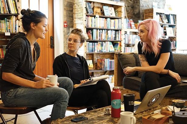 Rachel McCrystal, Lizz DeFeo, and Alexandra Shea of Woodstock Farm Sanctuary, at Rough Draft Bar & Books. - JOHN GARAY