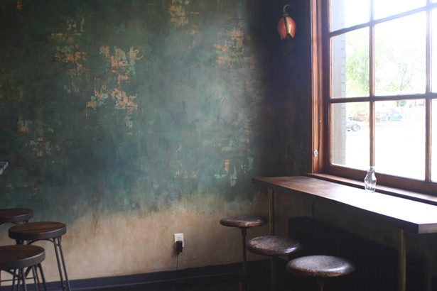 Patty and a friend hand-finished the bar wall to give it a textured, aged look. - MARIE DOYON