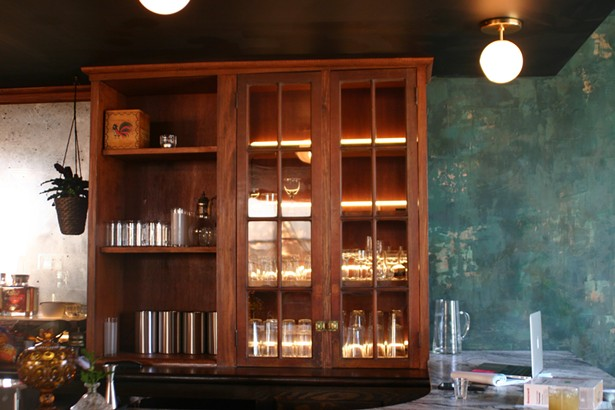 Neon tubes backlight the cabinets, which were custom built around vintage doors found at Zaborski's emporium to match the original wooden bar. - MARIE DOYON