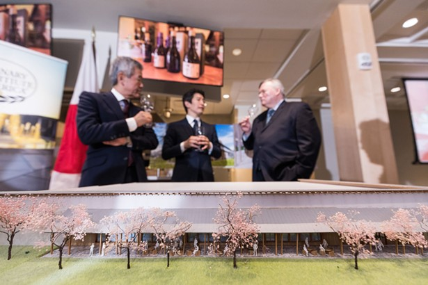 CIA President Dr. Tim Ryan (right), Asahi Shuzo President Kazuhiro Sakurai, and Chairman Hiroshi Sakurai talking about the sake education partnership between The Culinary Institute of America and Asahi Shuzo on April 10, 2018. In the foreground is a scale model of Asahi Shuzo's new brewery to be built in Hyde Park, NY. - PHOTO CREDIT: CIA/PHIL MANSFIELD