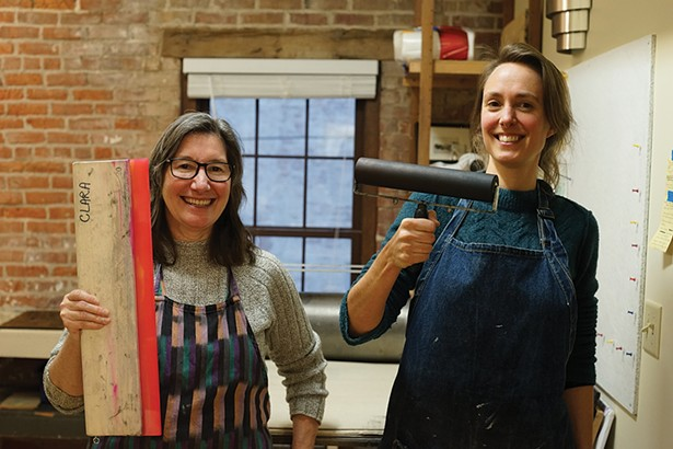 Anita Fina Kiewra, studio manager, and Emilie Houssart, studio assistant at PUF Print Studios at the Underwear Factory. - PHOTO BY JOHN GARAY