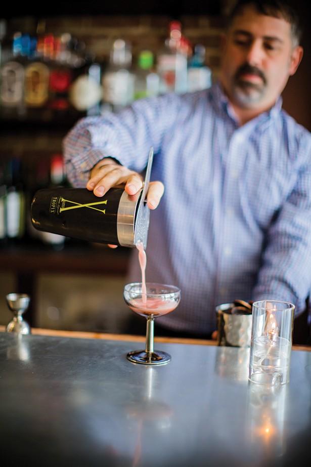 Head bartender David Garrett preparing a cocktail - PHOTOS BY MARY KELLY
