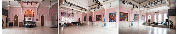 Once the center of Odd Fellows revelry, Bickman now utilizes the building's third floor ballroom as a community event space. Musical performances, aerial yoga and her Mural Arts Program are regularly held in the 24-foot-high room. Her 4' by 6'Laughing at Deathhangs above the mirror. Hanging amongst the arches, her 5' by 7' series contemplating spiritual themes was completed during her time in Florida. From left to right isDancing Shiva, Vajrayogini, Taming the Mind, Christ Buddha,andGreen Tara. - PHOTOS BY DEBORAH DEGRAFFENREID