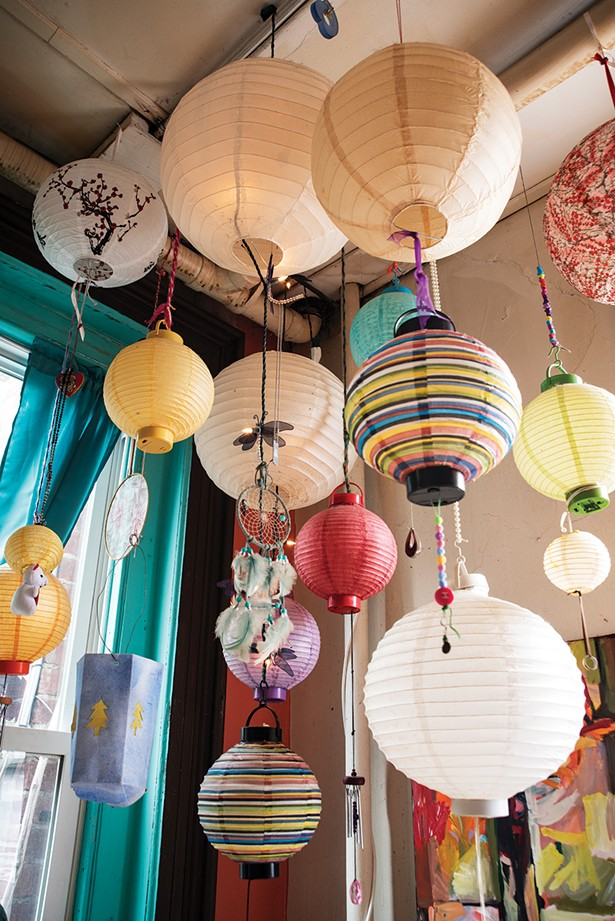 """The hanging installation includes gifts from her mother, crafts created by her daughter, and found objects —each one meaningful in its own way. """"It was all stuff jammed up in a junk drawer,"""" she remembers. """"I thought, so why not make it art?"""" - PHOTO BY DEBORAH DEGRAFFENREID"""