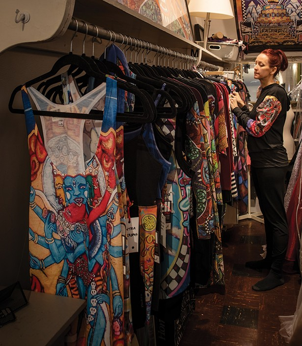 Bickman with some of her 11:11 brand clothing line. Painted with spiritually inspired motifs from her work, the line includes hoodies, yoga pants, tanks and shoes and is manufactured by a woman-run factory. - PHOTO BY DEBORAH DEGRAFFENREID