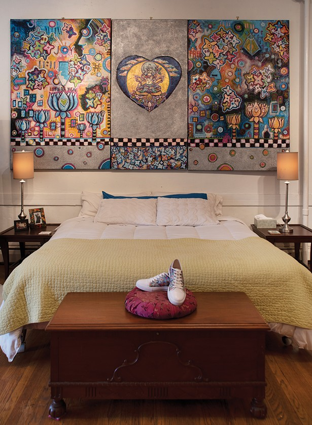 """Bickman's bedroom is decorated with her grandmother's hope chest and some of her work. Her shoes are painted with the cherry blossom motif which, along with skulls, reoccurs throughout her fine art. """"The skulls represent impermanence; the blossoms represent new life."""" - PHOTO BY DEBORAH DEGRAFFENREID"""
