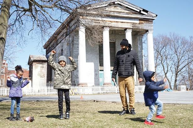 Carmela, Zach Jr., Giovanni, and Zachary Murry in front of the Dutch Reformed Church on Grand Street. - PHOTO: JOHN GARAY