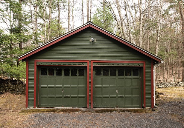 The wooded property includes a storage - space and garage. Her second book Junk: Digging Through America's Love Affair with Stuff details three years of riding along with junk removal companies all over the country. - PHOTO: DEBORAH DEGRAFFENREID