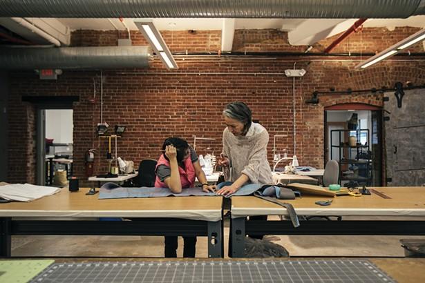 Artist Sigi Ahl with a Tiny Factory employee.