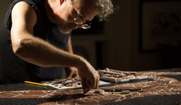 John T Unger working in his studio. - IMAGE COURTESY OF THE ARTIST.