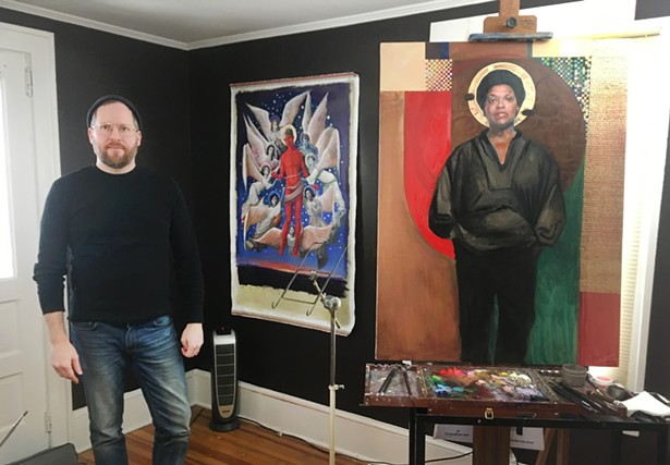 Carl Grauer in his Poughkeepsie, NY studio with his paintings of Audre Lorde (right) & The Ascension of Matthew Shepard (left)