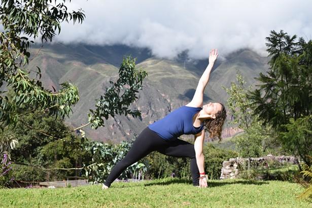 Sarah Wilkinson, owner of Saugerties Yoga, practicing at her annual Peru retreat. - PHOTO COURTESY OF SAUGERTIES YOGA