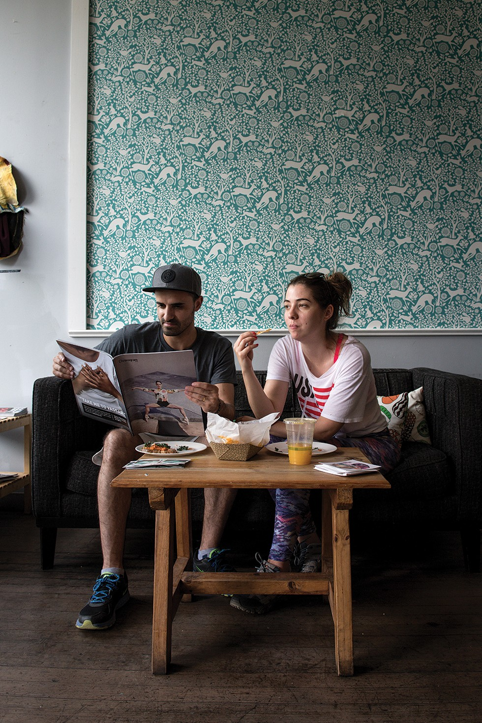 Sandro Figueiredo and Joana Martins enjoying Chronogram and lunch at Conscious Fork. - PHOTO: CHRISTINE ASHBURN