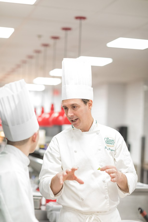 Chef Kaywork and a student in the kitchen, talking history and food. - PHOTO COURTESY OF CIA